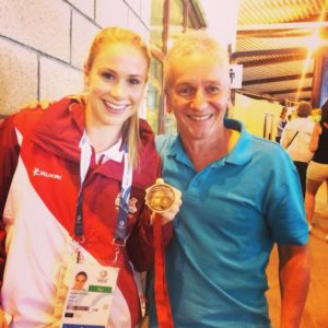 Sophie Hitchon and her Commonwealth Games Medal with Tony Wood Chairman of Blackburn Harriers