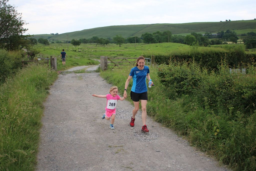 BMAF V35 5K Road Champion for 2017 taking her daughter for a warm up!