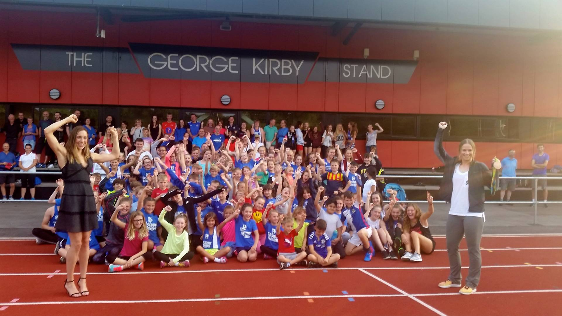 Blackburn Harriers celebrating with their Olympians